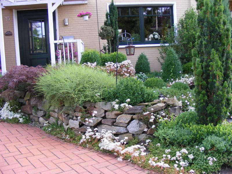 Garten und Landschaftsbau Hamm Melbert Pflasterarbeiten Gartenweg Natursteinmauer